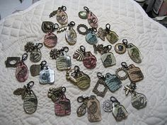 used the Tim Holtz Fragments for the base. I then stamped bird images on paper by KC Company. I attached the stamped image to the fragment using Glossy Accents by Ranger. I then added a charm from the 'Petals a Plenty' Collection by Plaid. All was then attached to a lobster clasp (required) that can be added to a necklace or a bracelet.