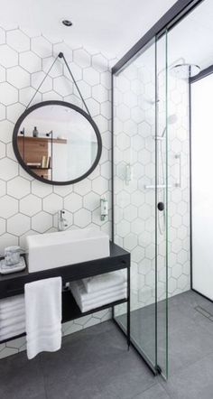 Hex tiles on wall, throughout shower and possibly behind vanity. Take note of the contrasting grout color. Do you like this?