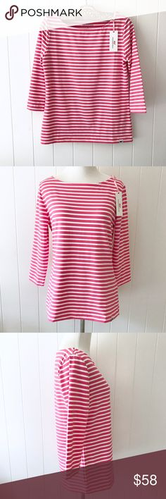 """NWT Vineyard Vines Boatneck Stripe Stretch Top A flattering three-quarter sleeve boatneck stretch top with bright coral nautical stripes in a feel good breathable fabric. With a whale logo embroidered on the hem and drop shoulders for a more relaxed fit. Perfect for a day by the shore!   ・Size: Small ・Condition: NWT, never worn ・Materials: 58% Nylon, 34% Polyester, 8% Spandex ・Measurements laid flat: 36"""" Bust, 24"""" Length, 15"""" Shoulders, 17"""" Sleeves  Pet friendly home • No trades/holds •…"""