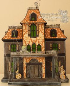 "The Haunted House in MAPLE MANOR SVG KIT is one of Mary's most amazing projects ever!! Well, they all are, but look at this! Celine has made the Haunted House and, wow, it is fantastic or should I say ""Fa-BOO-Lous"" as she said! Well, I agree! The added elements and patterned papers are just perfect and every haunted manor needs a few cobwebs! Awesome!"