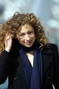 Alex Kingston. She's adorable and fabulous and I have a girl crush on her.