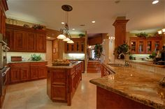 Granite counter tops, double ovens, ice maker and wine refrigerator.