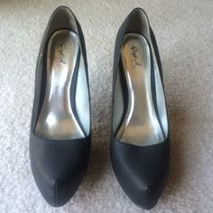 Qupid heels Matte black heels. There is some crackled design to these heels but it is almost unnoticeable. There are some scratches on these heels. There is a pic of the most significant scratch. Approximately 5 inches tall. Qupid Shoes Heels