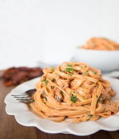 This take on Cheesecake Factory's Sundried Tomato Fettuccine is lightened up so you can enjoy more without the guilt!