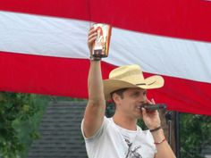 Dustin Lynch and Reba cup