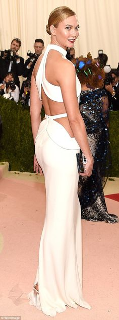 Halterneck hottie: Model Karlie Kloss was simply stunning in a cream cut-out gown...