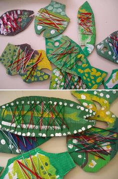 Threaded fish craft - slits cut round the edge of cardboard to thread the yarn after painting