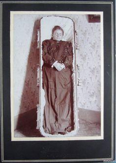 Woman in a standing casket