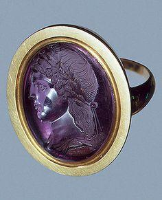 Head of Apollo     1st century BC - 1st century    Master Hyllos    Ancient Rome    Amethyst; intaglio