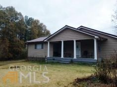 Gorgeous completely renovated 3 bedroom 2 bath, granite counter tops, hardwood floors, tile in kitchen and bathroom. Large bedrooms with sitting area. Back porch is screened in with tile flooring. A perfect place to relax and watch the wild life graze. New roof, new wiring, tons of upgrades!!! Two shops, barn and a pond. Home is on county water and has a well. Property has been fenced ready for your animals. All this sitting on almost 30 acres. This one is a must see.
