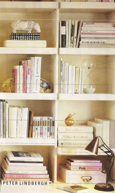 Bookcase Decor. Simply arranging similar color books in multiple positions #hippo @Sarah Keene