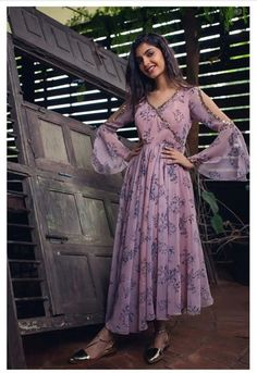 Beautiful Printed Chiffon-Silk Kurti with hand embroidery embellishment. Modern silhouette with traditional embellishments create sober design Indian Gowns Dresses, Indian Fashion Dresses, Indian Designer Outfits, Designer Dresses, Evening Dresses, Long Dress Design, Stylish Dress Designs, Stylish Dresses, Casual Gowns