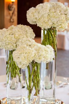 Bunches of Ivory Hydrangeas for a Simple, Elegant Centerpiece | Cariad Photography | See More: http://heyweddinglady.com/spring-green-southe...