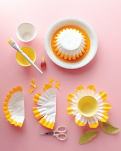 Create daffodil-shaped candy dishes for a fanciful table display using coffee filters and food coloring.  Tools and Materials