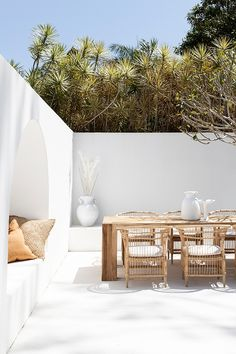 Hamptons Santorini inspired Byron Bay Beach House exterior! With rustic natural and white outdoor furniture by Uniqwa Furniture Collections. One of our favourite Australian outdoor patio entertaining areas! Furniture featured Hamali Block Dining Table, Songwhe Dining Chair Blonde, Alfresco Pot White, Senegal Cushion Cover, Original Naga Pot and Original Naga Fruit Tray. © Uniqwa Furniture Collections Furniture by @uniqwacollections Photography @villastyling Location @nirvanahouse.byronbay