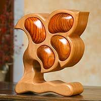 Hand-carved, this wood sculpture features little drawers. What a beautiful way to store clips and rubber bands.