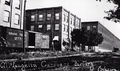 A010.23.1, Print, Photographic: Black and white copy of a postcard. Unique view of the McLaughlin Carriage Factory, showing the offices as well as the rail line.