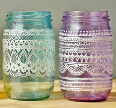 Hand painted purple and teal mason jars - perfect for wedding reception decor!
