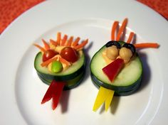 51. Lil' Cucumber Monsters Let the kids get creative and build their own little edible monsters made out of cucumber disks. Hummus or cream cheese makes for the perfect glue to hold it all together.