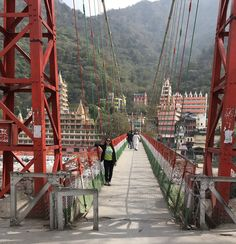 Here I stand on the amazing suspension bridge across the Ganges River. Laxman Juhla is a well traveled route high above the water, with a big view, and many diverse beings, not just all kinds of people- also cows, dogs,monkeys, motorcycles, bikes and everything! All at once.