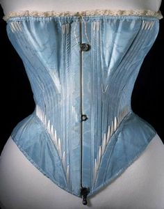 Corset (front view), blue silk stiffened with whalebone, possibly English or French, 1864.