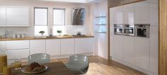Stockholm Kitchen. Sleek and contemporary, Stockholm's handle-less doors and white gloss finish create a luxuriously minimalist feel that's versatile, too. Team with oak worktops and flooring for a softer look, or a stone effect worktop for more high-end style.