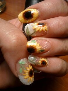Sunflower nail art. Don't like the index finger, but the rest of it is fun.