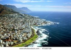 Cape Town, South Africa - Aerial view of Cape Town. Picturesque scenery of residential area, blue ocean and mountains.