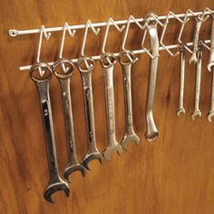 Hang wrenches on a tie/belt rack