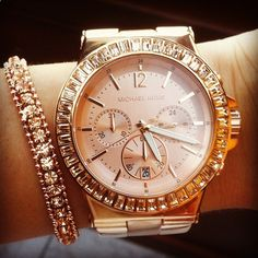 Rose gold bracelet watch.