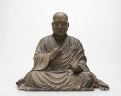 Edo period (circa 18th/early 19th century), a carved wooden sculpture a seated…