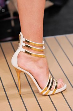 Metallic gold and white strappy stiletto heels
