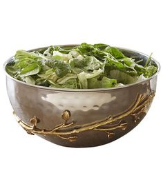 Bring some fall foliage into your home with this elegant two-toned serving bowl made of stainless steel with brass accents. Use it daily to serve salad or pasta, but on Halloween, fill it with mini wrapped candy to dole out treats in style.