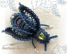 Blue Fly. The brooch, pin insect with Indian sapphires and Swarovski. Beads embroidery, beading weaving.