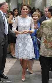Kate wearing a lace overlay dress