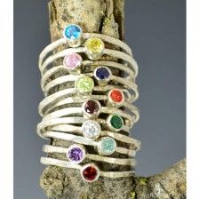 """These dainty mother's rings are perfect for a flash of silver and color on the hand, without being to """"much."""" These skinny rings are created with tiny conflict free cubic zirconia gemstones. These rings are beautifully worn alone or worn together in clusters."""