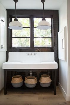 This California home by RailiCA design& a trendy take on modern farmhouse style. You've got some modern graphic tile, statement murals, rustic and industrial elements all joined together for a reall Farmhouse Apron Sink, Farmhouse Bathroom Sink, Industrial Bathroom, Modern Bathroom, Bathroom Trends, Bathroom Ideas, Bathroom Inspo, White Bathroom, Master Bathroom