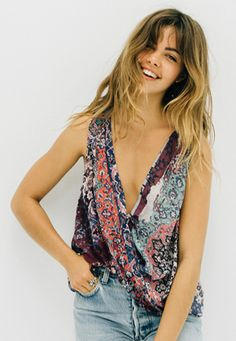 @mimielashiry in Nicole Miller's Magic Carpet Draped Top #NMwithdenim