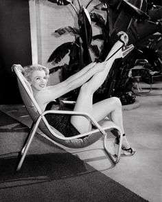 Frank Worth - Marilyn Monroe in Bathing Suit with Leg Up, Photograph