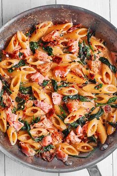 Salmon Pasta with Sun-Dried Tomato Cream Sauce and Spinach - quick and easy dinner made in 30 minutes! Pan-seared salmon is combined with the delicious penne in a flavorful, restaurant-quality cream sauce. Salmon is a Cooked Salmon Recipes, Leftover Salmon Recipes, Salmon Pasta Recipes, Creamy Salmon Pasta, Smoked Salmon Pasta, Salmon And Asparagus, Cooking Salmon, Seafood Recipes, Smoked Fish