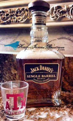 Mouthwash in an old liquor bottle.  Add some character to the bathroom with the upcycled Jack Daniels Bottle.     KayJamesboutique.com