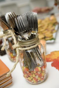 Baby Mama Juice: Fall Harvest Party 2012: IDEA-Give your silverware an extra boost, both vertically and aesthetically, by tossing some colorful candy into the bottom of a mason jar. This makes the silverware easy to access while looking festive as well. Top it all off with a tied piece of twine, jute, or string.