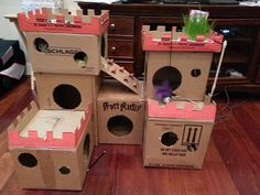 What happy cats must live here! Looks like the owner made this forum his/her cat(s). I did something similar years back when I had two cats but nothing this elaborate! If I made something like this now for my cat, she'd only chew it and spit out the pieces - what she likes doing to boxes.  :D