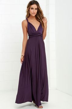 """Any which way you wrap it, the Always Stunning Convertible Purple Maxi Dress is one amazing dress! Two, 83"""" long lengths of fabric sprout from an elastic waistband and wrap into dozens of possible bodice styles including halter, one-shoulder, cross-front, strapless, and more. Stretchy dark purple fabric has a satiny sheen, and a full length maxi skirt pairs perfectly with any choice you make up top. Want Styling Tips? <a href='http://bit.ly/HowToWearIt' target='_blank'>See How To Wear…"""