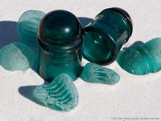 Various sea glass insulator shards along with the type of insulator that was the source many of these gems. Electric Insulators, Glass Insulators, Glass Bottles, Sea Glass Beach, Sea Glass Art, Sea Glass Jewelry, Glass Photography, Sea Glass Crafts, Insulation