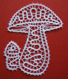 """Little Mushroom."" Bobbin lace by Jakica, of Idrija, Slovenia. It is made with white thread and it measures 10x8 cm (about 3,5x3 inches). About 3.5 hours of work-- very fun design."