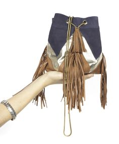 Emma Fringes is a day to night high quality leather mini bucket bag, for a laid back chic look.