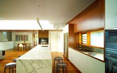 A small Breezway Louvre Window above the kitchen bench adds fresh air to a tight space.