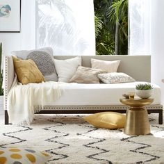Use a daybed like this one (Nailhead Trim Daybed by west elm) as a sleeping solution instead of a pull out or a futon.
