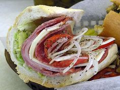 """A Philly classic!   """"Hoagie means many things to many people, but in Philadelphia cheese steak shops, it means a cold-cut sub, almost always presented with lettuce, onions, tomato, and a good spritz of oil. This is a cross-section of the classic Italian hoagie, made with salami, ham and provolone."""""""